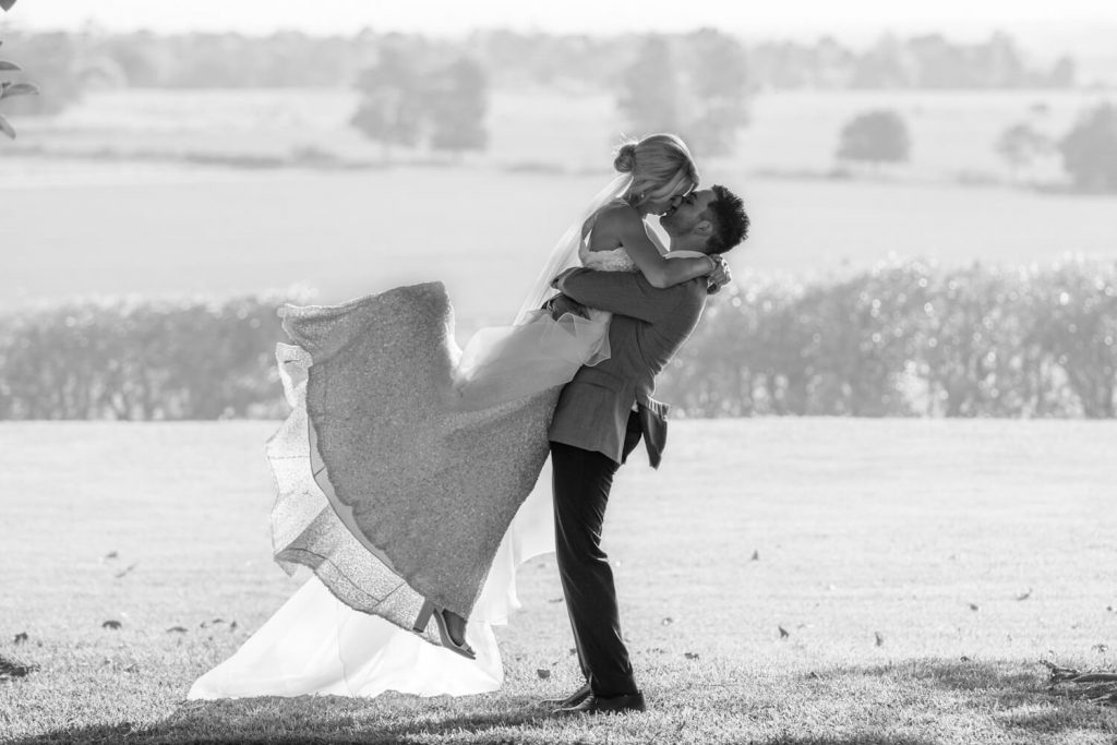 black and white wedding photography of Ash and Andrew kissing