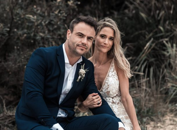wedding photography of justin and bec linking arms