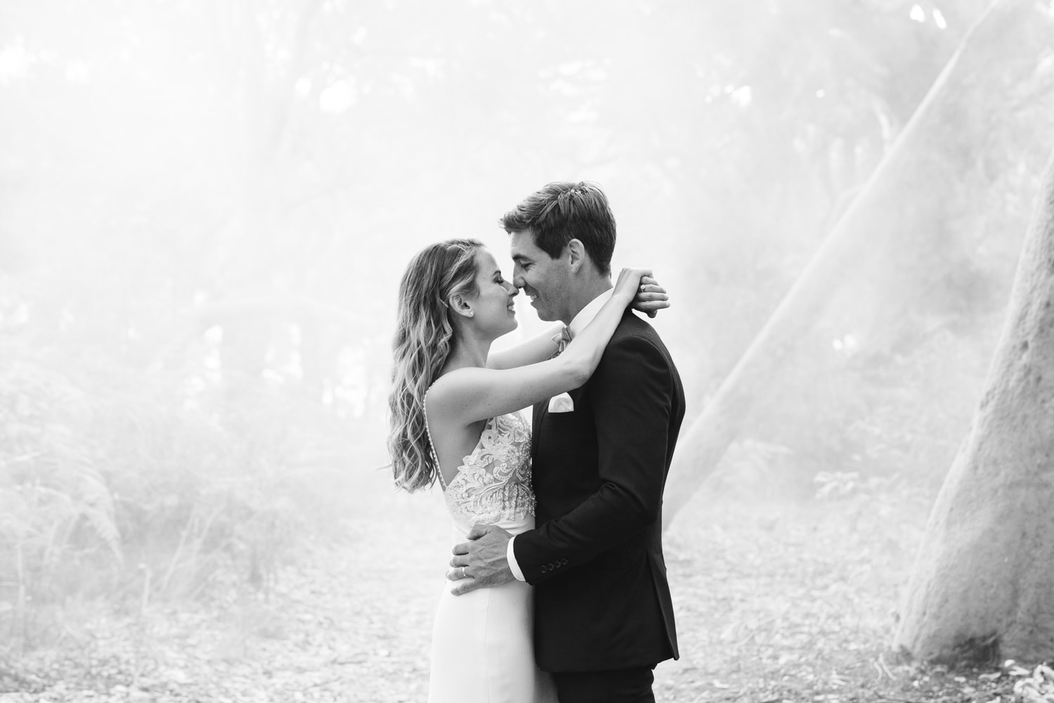 northern beaches wedding photography of a couple cuddling